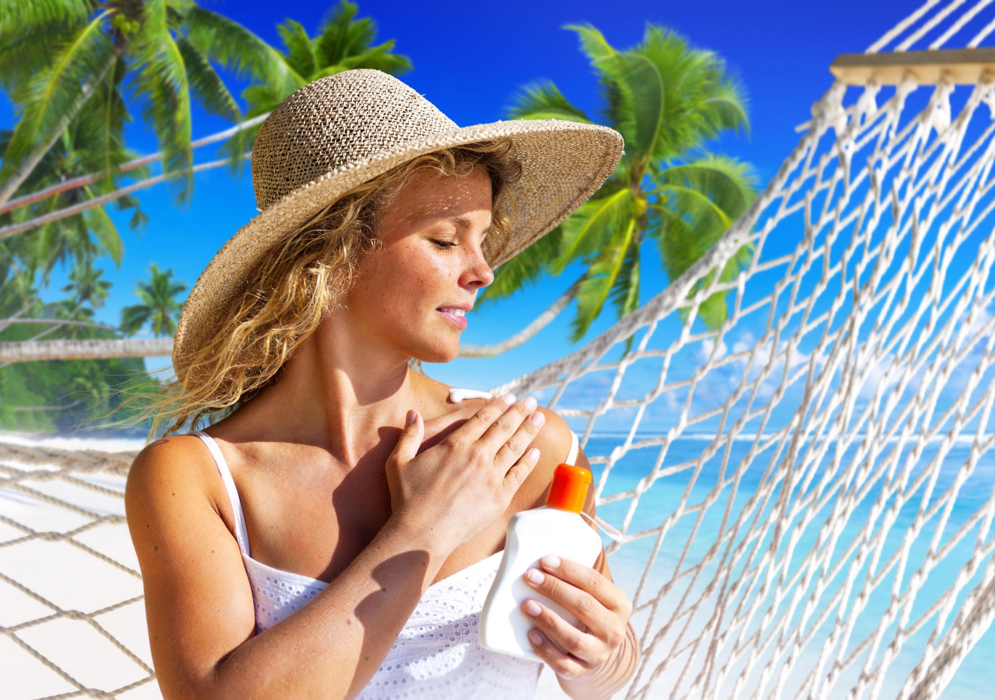 Woman Applying Sun Protection On skin